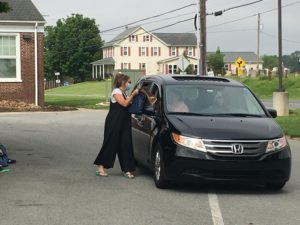 passing off supplies to a car